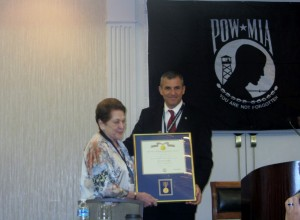 Former DPAA Director Michael Linnington presents POW/MIA League CEO Ann Mills Griffiths, the agency's first ever award for her long-time dedication to MIA families with loved ones unaccounted for from the Vietnam War. Photo was taken during the 2016 Annual League Meeting.