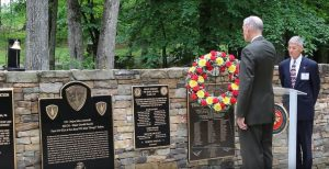 L-R: Col. Hays Parks & Col. Bob Lange, both retired Marines from Bravo Co., TBS, 1-67, taking part in the wreath laying portion of the ceremony. The memorial plaque is to the immediate left of the wreath.
