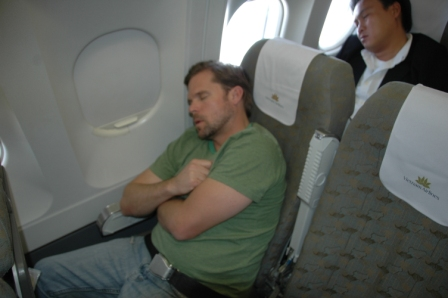 Craig recharging his batteries on flight to Danang