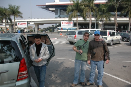 Craig and Brett getting linked up with our city guide, at airport in in Hanoi