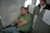 Craig recharging his batteries on flight to Danang