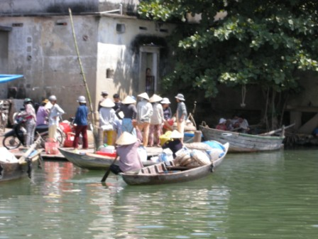 The Hoi An River offers a good view of Vietnam\'s market economy