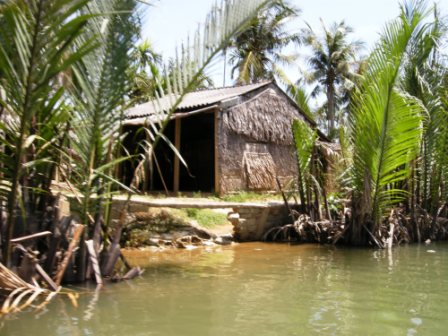 The old style homes made with dryed coconut palms are disappearing.