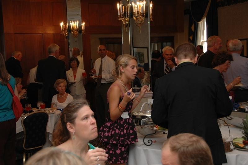 Stacy Slack (Pigott) (sitting), Alie Zimmer talking to her dad, Craig Zimmer (dark suit)