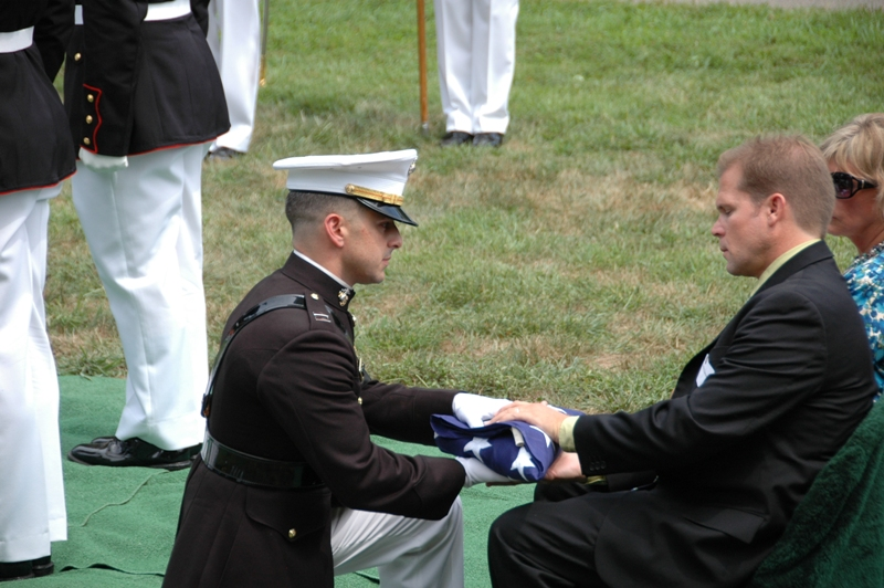 Craig receives the American Flag from the Commandant's Representative