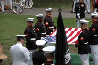 Marines perform the intricate, ceremonial flag folding process