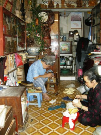 Owners of a wood carving shop take a lunch break