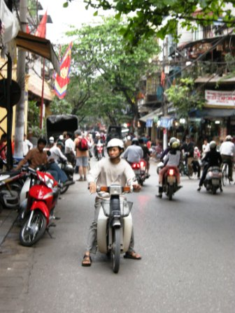 Motorscooters are the primary mode of travel in Vietnam, especially Hanoi
