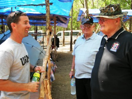 Capt Ernest Nordman USMC team leader discusses his current excavation assignment with VFWs Adjutant General Gunner Kent and Senior Vice Commander Richard Eubank