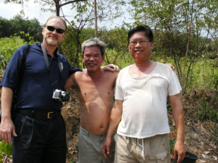 Det2's Ron Ward stops to talk (in Vietnamese) to village leaders near the excavation site.