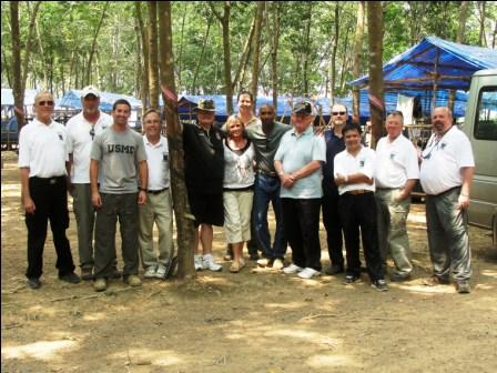 JPAC leadership and visitors pose for a photo before departing the excavation site.
