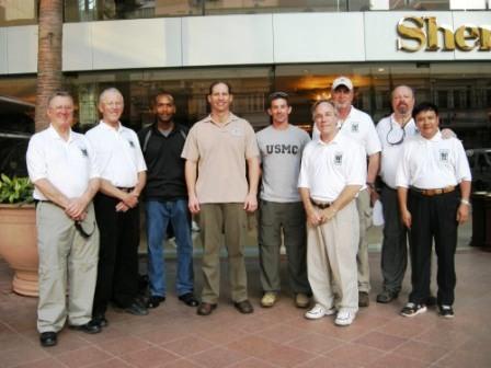 VVA and JPAC leadership: L-R:  Dan Tucker; Gary Jones; Maj Rafael Candelario, USMC; LtCol Todd Emoto, USA; Capt Ernest Nordman, USMC; Jack Devine, Bill Duker; Grant Coates; and Bui Van Nghi