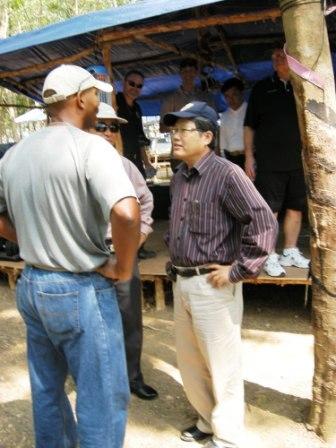 Maj Rafael Candelario, USMC, discusses the excavation with the Vietnamese leadership.