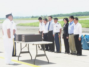 Participants in the Repatriation Ceremony included (Center) LTC Julian Tran, Commander of JPACs Detachment 2 in Hanoi, and U.S. Consul General Rena Bitter, from Ho Chi Minh City. Both are flanked by members of the Vietnam Office for Seeking Missing Persons.  The transfer of remains was about to take place.